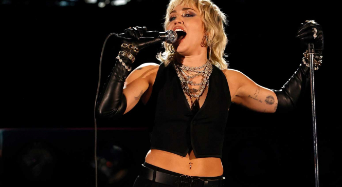 Miley Cyrus shares support to Britney Spears during a solo performance in LA